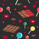 巧克力、棒棒糖和亲吻的无缝的样式 免版税库存照片