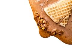 巧克力冰淇凌锥体在白色背景熔化了 图库摄影