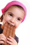 巧克力吃女孩 免版税库存图片