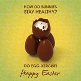 巧克力在春天背景的复活节彩蛋金字塔  皇族释放例证