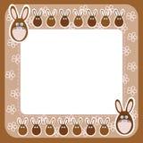 巧克力在框架的复活节兔子与花 图库摄影