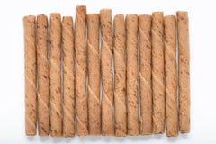 巧克力在白色背景隔绝的薄酥饼棍子 图库摄影