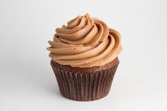 巧克力杯形蛋糕wth叉子 免版税图库摄影
