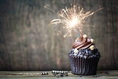 巧克力杯形蛋糕wth叉子 免版税库存照片