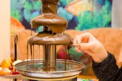 巧克力涮制菜肴 免版税库存图片