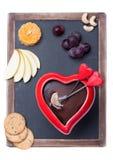 巧克力涮制菜肴和粉笔板 库存照片