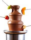 巧克力涮制菜肴喷泉用新鲜水果 库存图片