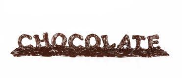 巧克力熔化的字 免版税库存照片