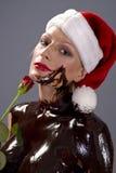 巧克力玫瑰色圣诞老人 库存照片