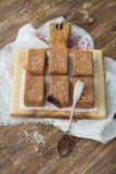 巧克力甜点用干果子和芝麻籽 库存图片