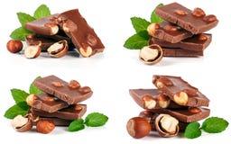 巧克力用榛子和薄菏在白色背景生叶隔绝 集合或汇集 免版税图库摄影