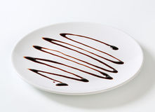 巧克力糖浆滴水 免版税库存图片