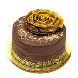 巧克力蛋糕洒与面包屑和金黄罗斯 库存图片