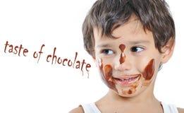 巧克力逗人喜爱的孩子一点 免版税库存照片