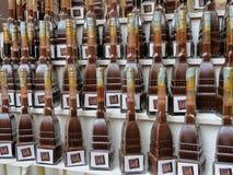 巧克力酒在痣antonelliana的专业bicerin塑造了瓶 免版税图库摄影