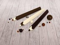 巧克力铅笔和球在木地板上 免版税库存图片