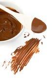 巧克力黑暗的水滴熔化匙子 免版税库存照片