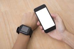 巧妙的手表和巧妙的电话技术小配件 库存照片