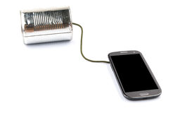巧妙的电话和锡罐电话我 免版税库存照片