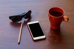 巧妙的电话和镜片个人项目商人的 库存照片