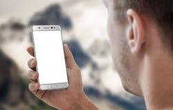 巧妙的电话在人手上 白色app大模型的被隔绝的显示 库存图片