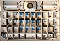 巧妙键盘的电话 库存图片