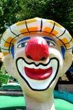 巨型小丑坚硬的小小高尔夫球 库存照片