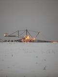 巨型挖掘机在一个煤炭露天开采矿晚上 库存图片