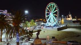 巨型时间间隔在卡斯卡伊斯,葡萄牙弗累斯大转轮招待的本机和游人 影视素材