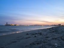 巨大海滩日落 免版税库存图片