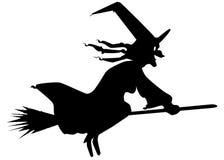 巫婆和笤帚剪影 免版税库存照片