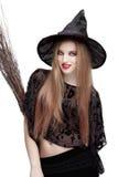 巫婆服装的女孩有笤帚的 免版税库存照片