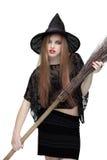 巫婆服装的女孩有笤帚的 免版税库存图片