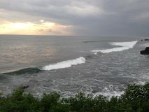 巴厘岛下来海洋太阳 库存照片
