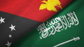 巴布亚新几内亚和沙特阿拉伯旗子纺织品布料 皇族释放例证