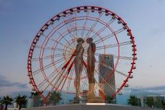 巴统 Nino和阿里移动的雕象  库存图片