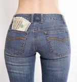 货币装在口袋里您 免版税库存照片