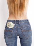 货币装在口袋里您 库存照片