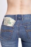 货币装在口袋里您 图库摄影