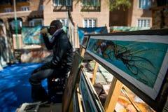 市场 绘画在一个地方市场上 库存图片