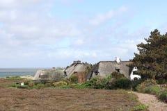 布拉德鲁普荒地的茅屋顶房子在叙尔特岛 免版税库存照片