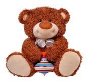 布朗与上面的玩具熊在它的手上 免版税图库摄影