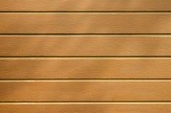 布朗与树树荫的板条地板  库存照片