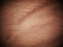 布朗丝绸缎纹理,棉织物背景 免版税库存图片