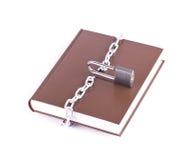 布朗书、挂锁和被撕毁的链子 免版税库存图片