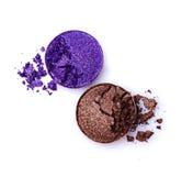 布朗和紫罗兰色发光的眼影膏 免版税图库摄影