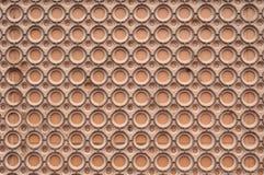 布朗圆塑料背景 免版税库存图片