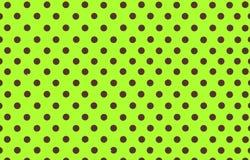 布朗圆点有黄绿色背景 库存照片