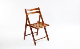 布朗在白色的折叠椅 免版税库存照片