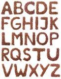布朗在白色隔绝的咖啡字母表 免版税库存图片